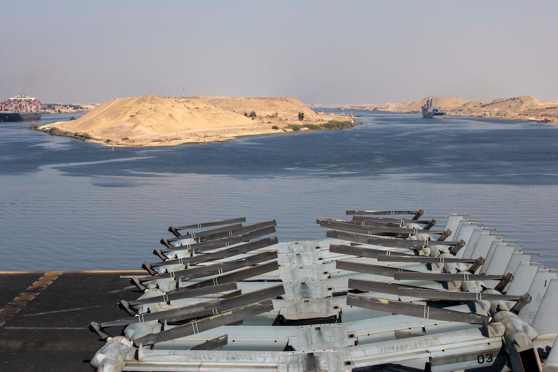 SUEZ CANAL (Sept. 20, 2021) Amphibious transport dock ship USS San Antonio (LPD 17), front right, and amphibious assault ship USS Iwo Jima (LHD 7) transit the Suez Canal, Sept. 20. Iwo Jima is deployed to the U.S. 5th Fleet area of operations in support of naval operations to ensure maritime stability and security in the Central Region, connecting the Mediterranean and Pacific through the western Indian Ocean and three strategic choke points. (U.S. Navy photo by Mass Communication Specialist Seaman Isaac A. Rodriguez)
