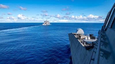 The Independence-variant littoral combat ship USS Charleston (LCS 18), right, sails alongside the Royal New Zealand Navy auxiliary ship HMNZS Aotearoa (A11), prior to a replenishment-at-sea.
