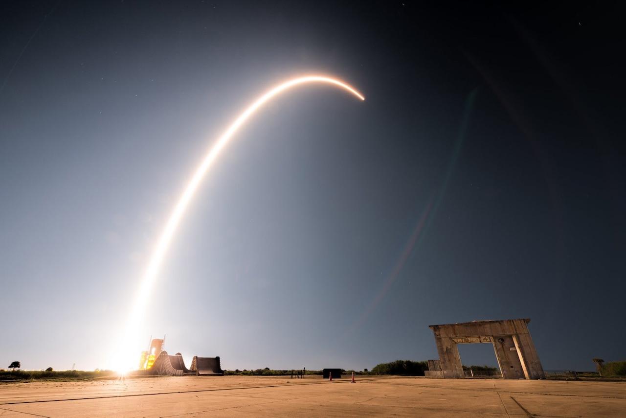 Rocket arches through the sky to orbit.
