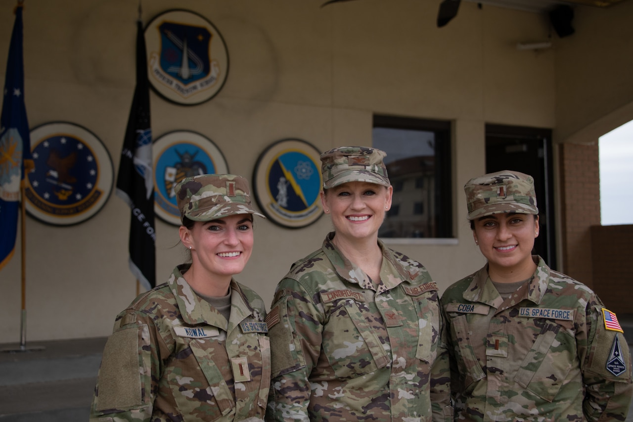 Two Space Force lieutenants pose with Air Force colonel.