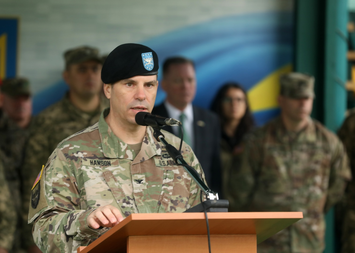 U.S. Army Col. Michael Hanson, co-director of Rapid Trident 21 from the U.S. Army, speaks to a multinational force during the opening ceremony for Rapid Trident 21, an annual Ukrainian-American training exercise, Sept. 20, at Central City Stadium.