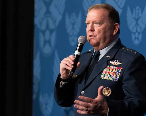Air Force Reserve commander Lt. Gen Richard Scobee speaks into a microphone.