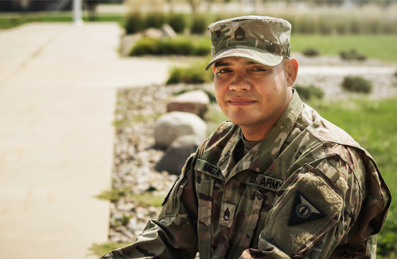 Staff Sgt. Henry Meza, an Iowa Army National Guard Soldier who works with the Service to Citizenship program, poses for a photo at the Camp Dodge Joint Maneuver Training Center in Johnston, Iowa, on Sept. 7, 2021. Meza grew up with a large family in Honduras, and became a U.S. citizen in 2013.