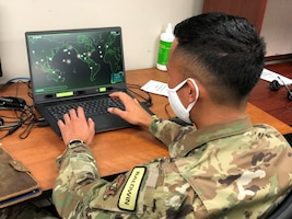 Airman working on a computer