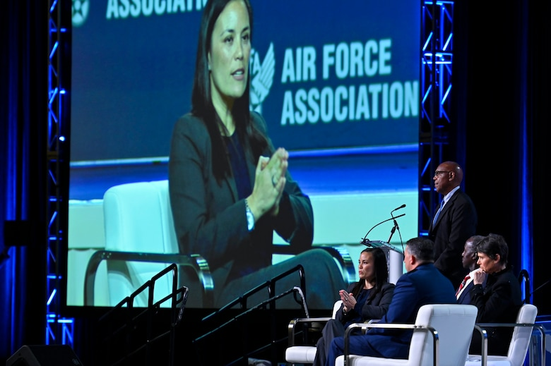 """Under Secretary of the Air Force Gina Ortiz Jones makes remarks during the """"It's All About People"""" panel discussion at the 2021 Air Force Association Air, Space and Cyber Conference in National Harbor, Md., Sept. 22, 2021. Joining Jones were moderator Larry Spencer; retired Gen. Edward Rice, former commander of Air Education and Training Command; Patricia Mulcahy, U.S. Space Force chief human capital officer; and Air Force Lt. Gen. Brian Kelly, deputy chief of staff for manpower, personnel and services. (U.S. Air Force photo by Eric Dietrich)"""