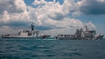 U.S. Coast Guard Cutter Munro steams in formation with Indonesia Coast Guard Vessel KN Pulau Dana during a maritime engagement with the Indonesia Coast Guard in the Singapore Straight, Sept. 20, 2021. Coast Guard Cutter Munro is currently deployed to the Western Pacific Ocean to strengthen alliances and partnerships, and improve maritime governance and security in the region.