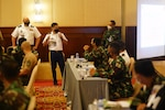 Lt. Col. Brandon Torres, Hawaii Army National Guard, discusses the operational design process with a team of military planners from the Tentara Nasional Indonesia (TNI) and the Hawaii National Guard, Sept. 16, 2021, Jakarta Indonesia. The operational design workshop in the precursor exercise for Exercise GEMA BHAKTI and is facilitated by the Hawaii National Guard with the Tentara Nasional Indonesia (TNI) as a part of the State Partnership Program.