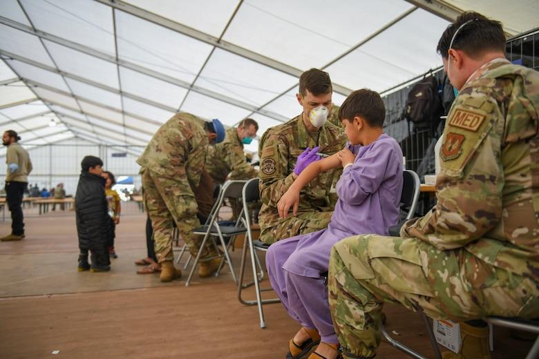 Airmen administer MMR vaccines.