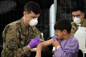 Airman administers vaccine.