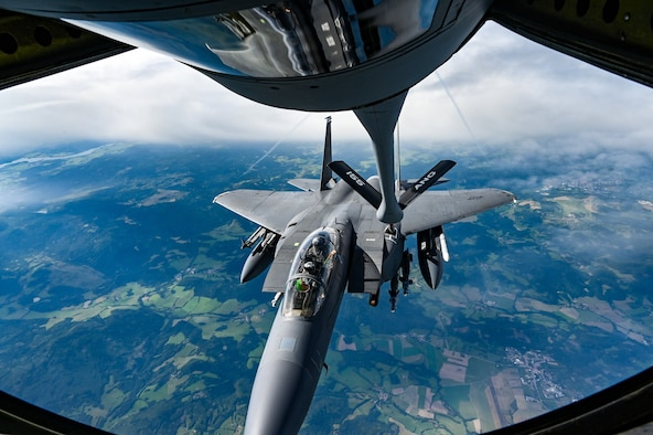 An F-15E Strike Eagle assigned to the 48th Fighter Wing, RAF, Lakenheath, England, is refueled by a U.S. Air National Guard KC-135R Stratotanker from the 155th Air Refueling Wing, Nebraska ANG, Sept. 15, 2021, during exercise Ample Strike 2021, near Pardubice Airport, Czech Republic.