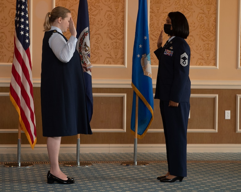 Maj. Erica Legg, 192nd Support Squadron director of operations, performs the Oath of Enlistment for Chief Master Sgt. Lawanda Jackson, 192nd SS Mobility Flight chief, during her promotion ceremony on July 10, 2021, at Joint Base Langley-Eustis, Virginia. When an Airman is promoted to chief, it is tradition to perform the Oath of Enlistment. (U.S. Air National Guard photo by Staff Sgt. Bryan Myhr)
