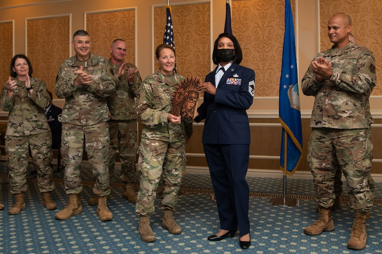 The 192nd Wing Chiefs' Council presents Chief Master Sgt. Lawanda Jackson, 192nd Support Squadron Mobility Flight chief, with a plaque during her promotion ceremony on July 10, 20221, at Joint Base Langley-Eustis, Virginia. Jackson was the first Black woman to be promoted to chief in the history of the Virginia Air National Guard. (U.S. Air National Guard photo by Tech. Sgt. Eugene Silvers)