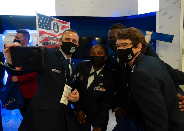 Senior Airman Jamonica Smith, 87th Security Forces Squadron Phoenix Raven Team member, Joint Base McGuire-Dix-Lakehurst, poses for a photo with Gen. Jacqueline D. Van Ovost, commander of Air Mobility Command, and Chief Master Sergeant Brian P. Kruzelnick, command chief of Air Mobility Command, during the Air Force Association Air, Space and Cyber Conference at National Harbor, Md., Sept. 20, 2021. Smith was recognized as one of the 2021 12 Outstanding Airmen of the Year based on superior leadership, job performance and personal achievement. (U.S. Air Force photo by Staff Sgt. Nicolas Z. Erwin)