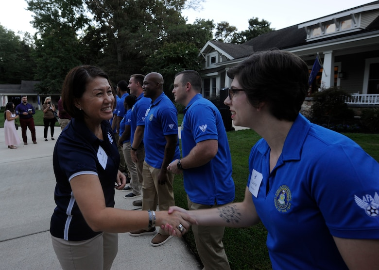 Chief Master Sgt. of the Air Force JoAnne S. Bass congratulates Staff Sgt. Valerie Graw, an 88th Communications Squadron cyber operations controller, during a social hour hosted for the 2021 12 Outstanding Airmen of the Year at Joint Base Andrews, Md., Sept. 19, 2021. Graw was recognized as one of the 2021 12 Outstanding Airmen of the Year based on superior leadership, job performance and personal achievement. (U.S. Air Force photo by Staff Sgt. Nicolas Z. Erwin)