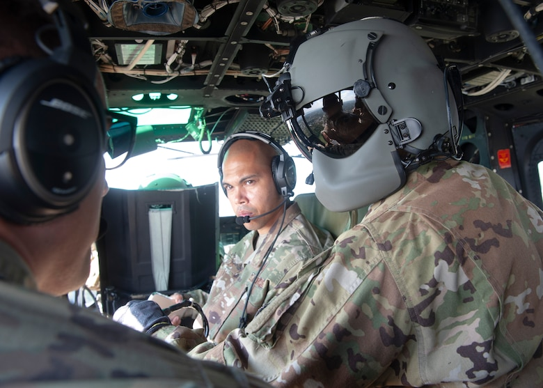 Senior Master Sgt. Christopher Ricks, Pacific Air Forces Security Forces Division current operations superintendent, and Staff Sgt. Alex Sandmann, 5th Security Forces Squadron noncommissioned officer in charge of electronic security systems, Minot Air Force Base, N.D.,  fly in a UH-1N Huey during a tour of the 1st Helicopter Squadron at Joint Base Andrews, Md., Sept. 18, 2021.  The 2021 12 Outstanding Airmen of the Year honorees were given the opportunity to tour the helicopter squadron, and received an aerial tour of the national capital region. (U.S. Air Force photo by Staff Sgt. Nicolas Z. Erwin)