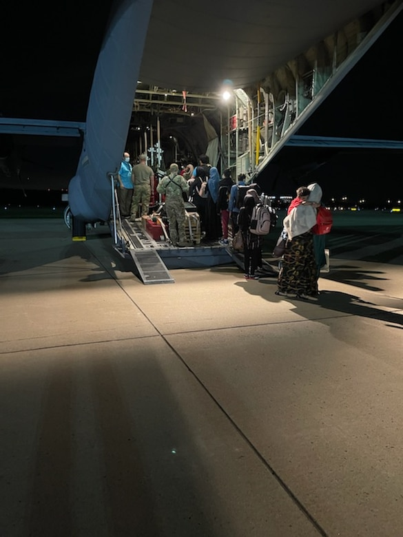 94th Airlift Wing loadmasters assigned to Dobbins Air Reserve Base, Georgia, escort Afghan evacuees onto a C-130H3 Hercules at Washington-Dulles airport prior to travel as part of Operation Allies Welcome, Sept. 4, 2021.