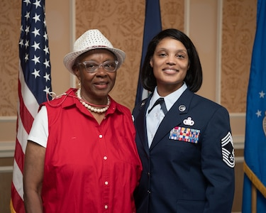 Retired Senior Master Sgt. Dorothy May Tatem and Chief Master Sgt. Lawanda Jackson, 192nd Support Squadron Mobility Flight chief, pose for a photo at Jackson's promotion ceremony on July 10, 20221, at Joint Base Langley-Eustis, Virginia. Tatem was the first Black woman to enlist into the VaANG and Jackson the first Black female to become chief master sergeant. (U.S. Air National Guard photo by Staff Sgt. Bryan Myhr)