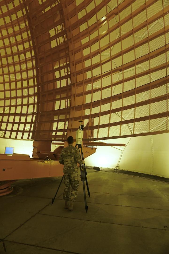 U.S. Airman standing in front of radar