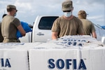 Louisiana National Guardsmen distribute food and water to the community during the recovery from Hurricane Ida, in Lockport, La., Aug. 31, 2021, during the recovery from Hurricane Ida.