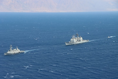 GULF OF AQABA (August 31, 2021) – Israeli Navy corvette INS Eilat (501), left, guided-missile cruiser USS Monterey (CG 61), center, and an Israeli Navy fast patrol boat transit in formation during a combined maritime security patrol in the Gulf of Aqaba, Aug. 31. Monterey is deployed to the U.S. 5th Fleet area of operations in support of naval operations to ensure maritime stability and security in the Central Region, connecting the Mediterranean and Pacific through the western Indian Ocean and three strategic choke points. (U.S. Navy photo by Naval Air Crewman 2nd Class Jesse Johnston)