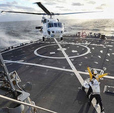 USS Benfold (DDG 65) conducts flight operations with the Japan Maritime Self-Defense Force.