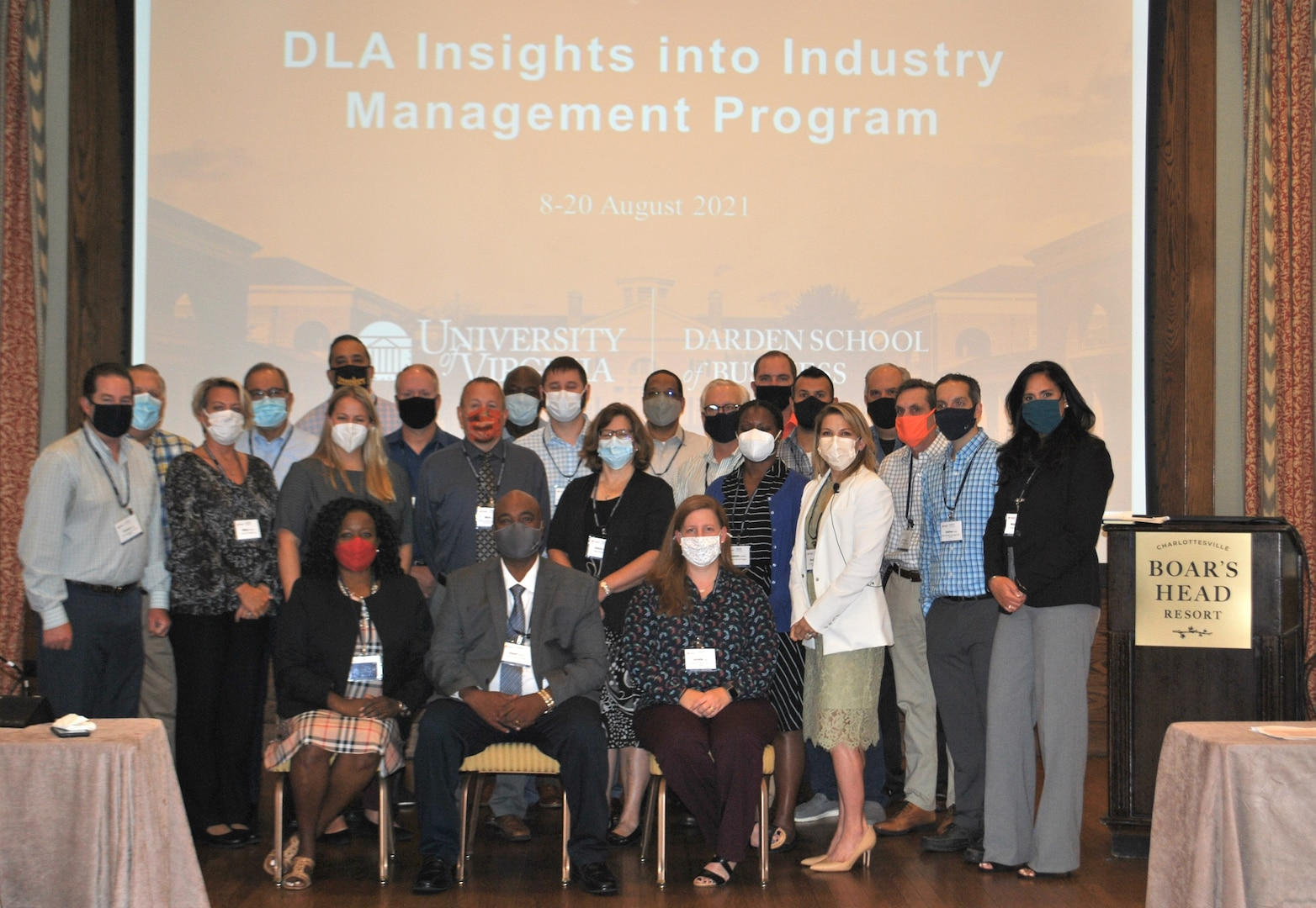 Group of men and women pose during  Insights into Industry Management Course.