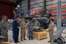 Vice Adm. Brad Cooper, commander of U.S. Naval Forces Central Command (NAVCENT), U.S. 5th Fleet and Combined Maritime Forces, center right, along with Major Gen. Ala Abdulla Seyadi, commander of the Bahrain Coast Guard, center left; and Rear Adm. Mohammed Yousif Al Asam, commander of the Royal Bahrain Naval Force, right, listen to a presentation on an unmanned aerial vehicle V-BAT system. During the visit, Bahraini leaders committed to partnering with NAVCENT to accelerate integration of new unmanned systems into regional maritime operations.