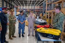 Vice Adm. Brad Cooper, commander of U.S. Naval Forces Central Command (NAVCENT), U.S. 5th Fleet and Combined Maritime Forces, center left, along with Major Gen. Ala Abdulla Seyadi, commander of the Bahrain Coast Guard, left; and Rear Adm. Mohammed Yousif Al Asam, commander of the Royal Bahrain Naval Force, center right, listen to a presentation on remotely operated unmanned underwater vehicles. During the visit, Bahraini leaders committed to partnering with NAVCENT to accelerate integration of new unmanned systems into regional maritime operations.