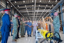 Vice Adm. Brad Cooper, commander of U.S. Naval Forces Central Command (NAVCENT), U.S. 5th Fleet and Combined Maritime Forces, center right, along with Major Gen. Ala Abdulla Seyadi, commander of the Bahrain Coast Guard, center left; and Rear Adm. Mohammed Yousif Al Asam, commander of the Royal Bahrain Naval Force, right, listen to a presentation on a Razorback unmanned underwater vehicle. During the visit, Bahraini leaders committed to partnering with NAVCENT to accelerate integration of new unmanned systems into regional maritime operations.