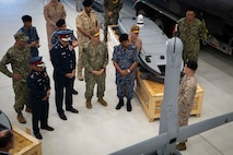 Vice Adm. Brad Cooper, commander of U.S. Naval Forces Central Command (NAVCENT), U.S. 5th Fleet, and Combined Maritime Forces, center right, along with Major Gen. Ala Abdulla Seyadi, commander of the Bahrain Coast Guard, center left; and Rear Adm. Mohammed Yousif Al Asam, commander of the Royal Bahrain Naval Force, right, listen to a presentation on an unmanned aerial vehicle V-BAT system. During the visit, Bahraini leaders committed to partnering with NAVCENT to accelerate integration of new unmanned systems into regional maritime operations.