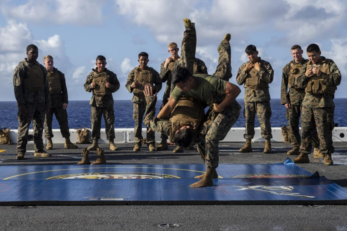 U.S. Marine Corps Sgt. Douglas Jimenez, a Marine Corps Martial Arts Instructor with 5th Battalion, 11th Marine Regiment, 1st Marine Division, demonstrates a technique during MCMAP training aboard the amphibious transport dock ship USS John P. Murtha while underway in the Pacific Ocean, July 23, 2021. Exercise Freedom Banner is designed for 1st Marine Expeditionary Force to train a Maritime Prepositioning Force by establishing an Expeditionary Advanced Base and increase relations in the Indonesian Pacific region.