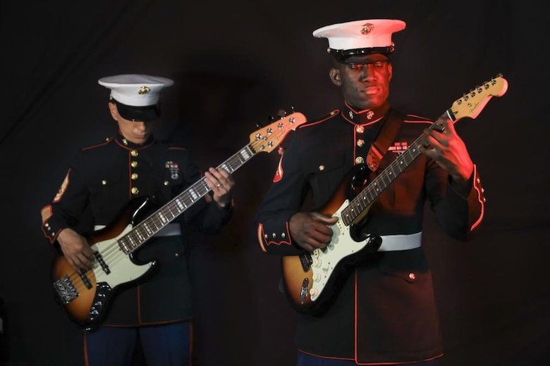U.S. Marines with the Parris Island Marine Band play the electric and bass guitar aboard Marine Corps Recruit Depot Parris Island, South Carolina, April 10, 2021. Portraits of band members were taken in support of the Musicians Enlistment Option Program.