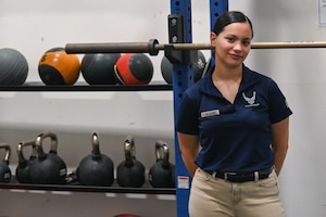 a woman stands inside gym