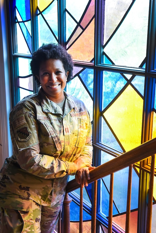 Chaplain (Capt.) Kimberly Hall, installation chaplain, stands outside the chapel at Hanscom Air Force Base, Mass., Sept. 22. Hall views the chapel as a lighthouse, serving as a beacon of faith for the community. (U.S. Air Force photo by Lauren Russell)