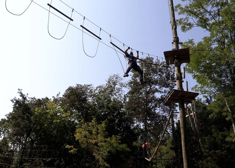 Fort Loudoun Lock Navigation Facilities Manager Matthew Emmons climbs his way across one of the most challenging obstacles at the Adventure Park as one of his final challenges during the yearlong LDP II course in Nashville, Tennessee.