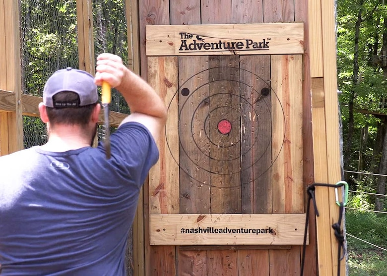 Allen Malcomb, U.S. Army Corps of Engineers Nashville District civil engineer, lines up his throw in hopes of hitting a bullseye and helping his team win the ax throwing competition during his final LDP II challenge at the Adventure Park in Nashville, Tennessee.