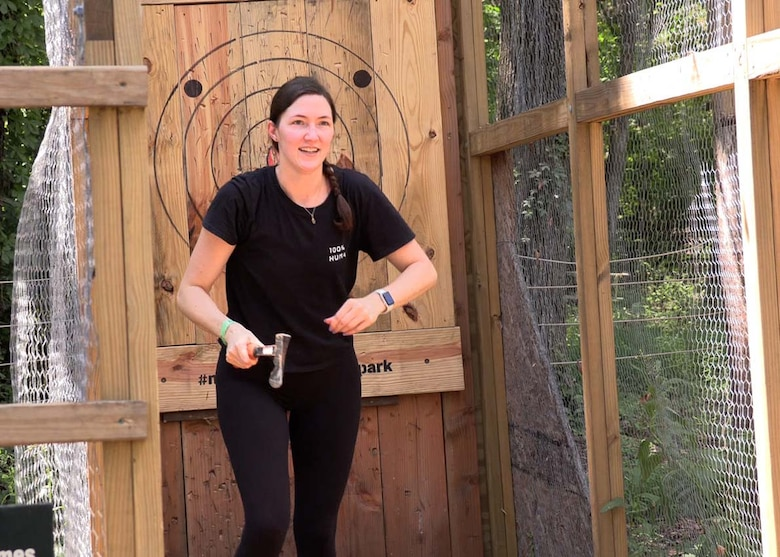 U.S. Army Corps of Engineers Nashville District Assistant District Counsel Johanna Anderson retrieves her ax from the target at The Adventure Park at Nashville, Tennessee, earning points for her team during a friendly ax throwing competition as one of the final challenges in the LDP II program.