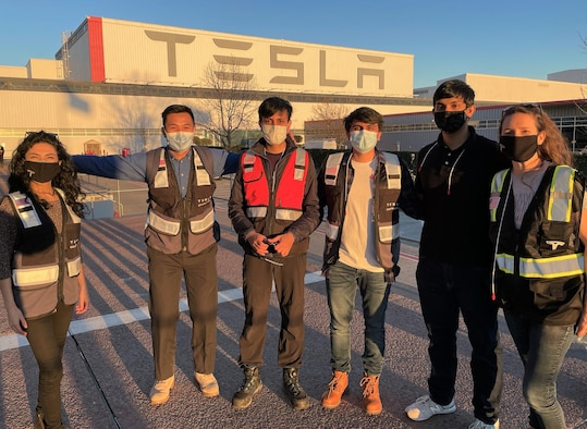 Maj. Joelle Uribe in a group photo with Tesla employees.