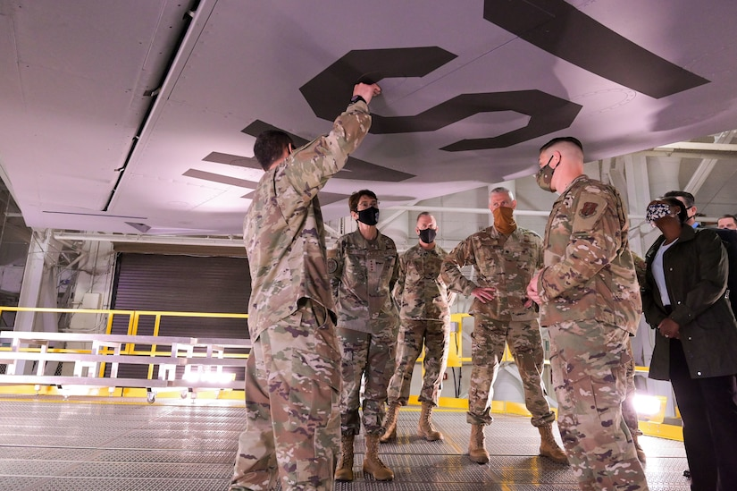 Airmen check the advantages of new aircraft stands.