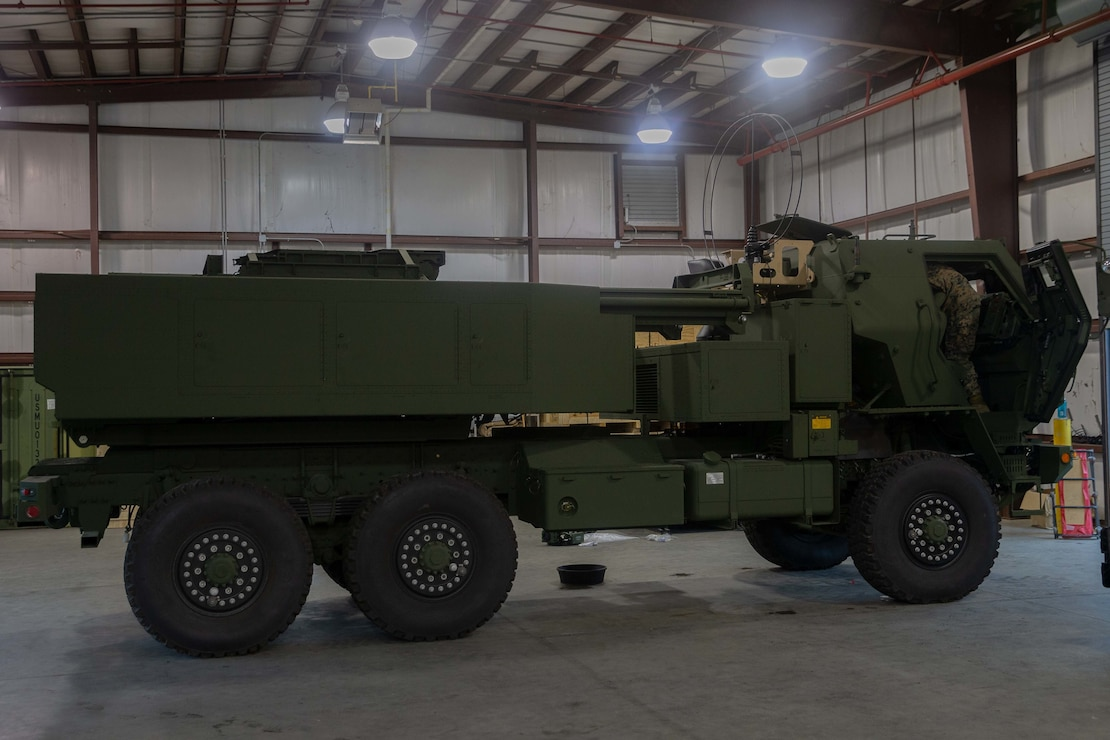 U.S. Marines with 1st Battalion, 10th Marine Regiment, 2d Marine Division (2d MARDIV) and Defense contractors work on a new High Mobility Artillery Rocket System (HIMARS) at Camp Lejeune, N.C., Sept. 22, 2021. The new, organic HIMARS capability will expand 2d MARDIV's ability to employ long-range, precision fires and improve its readiness to fight at a moment's notice. (U.S. Marine Corps photo by Lance Cpl. Michael Virtue)