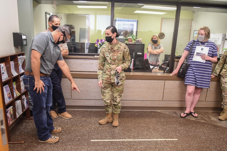 """Dr. Chad Wiginton, 97th Healthcare Operations Squadron honorary commander, attempts to identify a taped line to U.S. Air Force Tech. Sgt. Delena Ruiz, 97th Mental Health Flight supervisor, while wearing """"drunk goggles"""" at the Mental Health Clinic at Altus Air Force Base, Oklahoma, Sept. 17, 2021. The honorary commanders learned about the assessment, treatment and education provided by the 97th Mental Health Flight on a wide range of psychological and emotional issues as well as how they manage the Family Advocacy Program and Alcohol and Drug Abuse Prevention and Treatment Program. (U.S. Air Force photo by 2nd Lt Cameron Silver)"""
