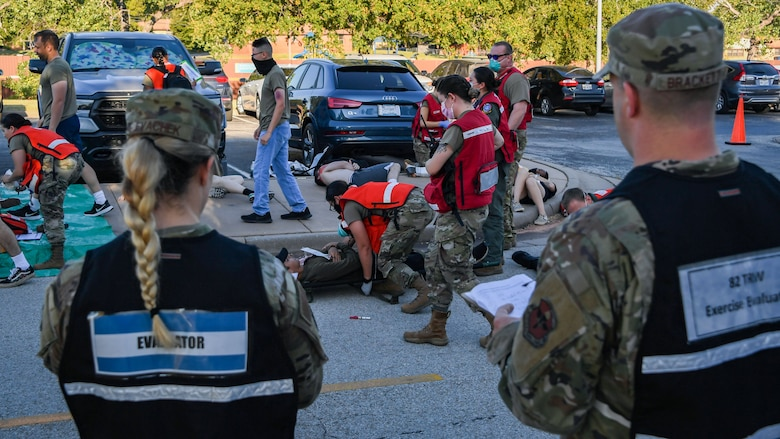Evaluators watch as personnel from the 82nd Medical Group take care of patients during a Ready Eagle exercise