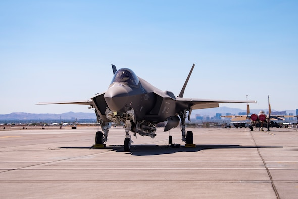 An F-35A Lighting II from Hill Air Force Base, Utah, carrying a B61-12 Joint Test Assembly sits on the flight line at Nellis Air Force Base, Nevada, Sept. 21, 2021. Two F-35A Lightning II aircraft released B61-12 Joint Test Assemblies during the first Full Weapon System Demonstration, completing the final flight test exercise of the nuclear design certification process. (U.S. Air Force photo by Airman 1st Class Zachary Rufus)