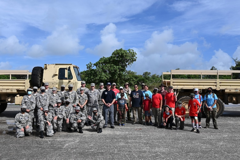 Members of the Andersen Civil Air Patrol Chapter, boy scouts, and volunteers from the 36th Contingency Response Group pose for a group photo during a search and rescue training day at Andersen Air Force Base, Guam, May 22, 2021. Emergency rescue operations is one of three major focus areas within the CAP. Senior Airman Cody Chenowith spends his days balancing his duties at the 36th Civil Engineer Squadron, base Honor Guard and re-launching the Guam CAP chapter, where he leads his team as the Andersen Flight Commander. (U.S. Air Force photo by Tech. Sgt. Esteban Esquivel)