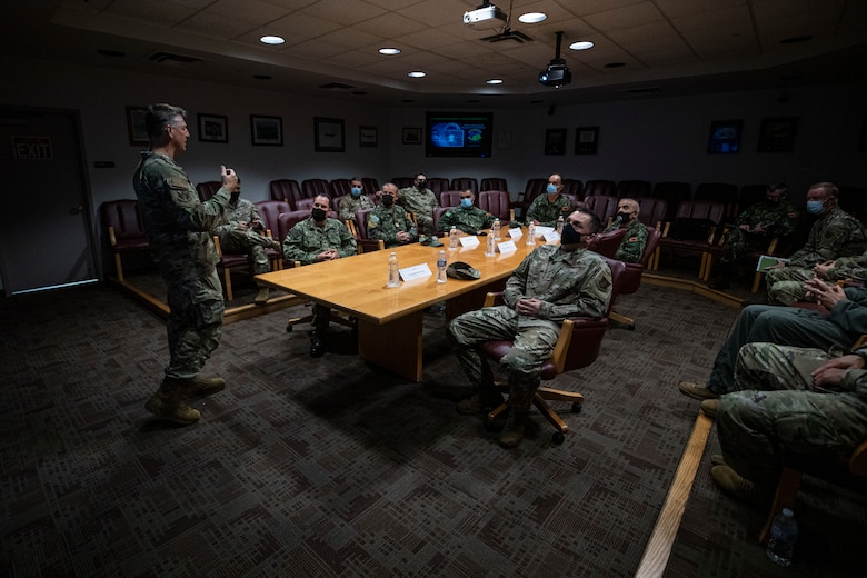 U.S. Air Force Brig. Gen. Bradford R. Everman, New Jersey Air National Guard Chief of Staff, left, briefs members of the Albanian Armed Forces during a tour of the 108th Wing on Joint Base McGuire-Dix-Lakehurst, N.J., Sept. 23, 2021.