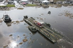 Louisiana National Guard members with the 2225th Multi-Role Bridge Company ferry emergency responders and equipment from Lafitte to Barataria to assist locals with recovery efforts, Jean Lafitte, La., Sept. 4, 2021. The only bridge to Barataria was damaged during Hurricane Ida and was rendered inoperable.