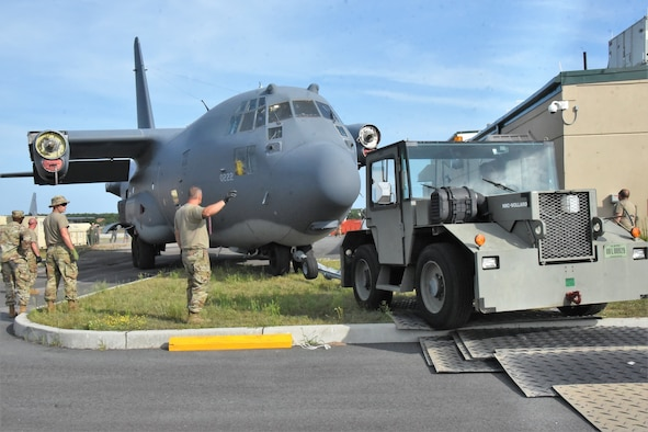 """""""The Spirit of Long Island"""" HC-130 Hercules aircraft, tail number 0222, which saw service during the Vietnam War and later assigned to the New York Air National Guard 106th Rescue Wing located at Francis S. Gabreski Air National Guard Base, Westhampton Beach, New York, until its decommissioning in 2019, is moved from the flight line to its static display site at the entrance of the base on, August 16, 2021. The disassembling and move was completed by Air National Guard service members from New York, Connecticut, Arkansas, and US Air Force Active-duty personnel. (U.S Army National Guard photo by New York Guard Cpt Mark Getman)"""