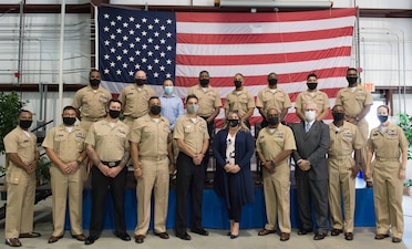 210921-N-MY760-1068 (Sep. 21, 2021) Sailors pose for a photo during the initial graduation for the Electromagnetic Aircraft Launch Systems (EMALS) course, held Sept. 21, 2021. The event was held the CNATTU training Building located on Naval Station Norfolk. (U.S. Navy Photo by Mass Communication Specialist 3rd Class (SW) Joseph T. Miller)