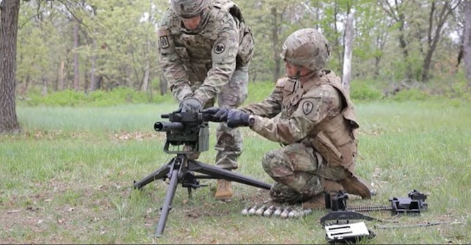 Cmd. Sgt. Maj. Andrew Lombardo, Army Reserve Command Sergeant Major, demonstrates the Expert Soldier Badge tasks for the MK19 grenade launcher.