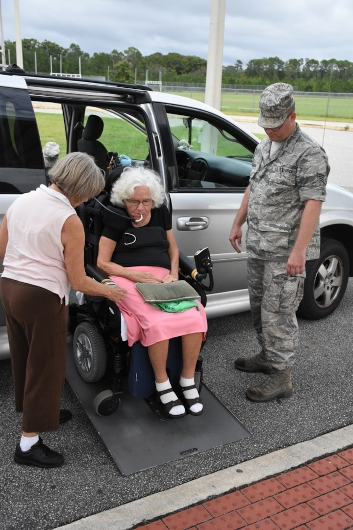 Florida Air National Guardsmen from the 125th Fighter Wing assist citizens with special needs into a special needs shelter opened at the Atlantic Coast High School in Jacksonville, Florida Sept. 9, 2017. The shelter is one of 11 opened in Duval County to protect citizens from Hurricane Irma. (Air National Guard photo by Master Sgt. William Buchanan/Released)